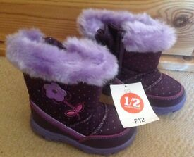 Brand new girls snow boots. Size 7