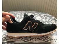 New balance black trainers . Size 4