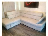 Corner sofa with storage and expandable side