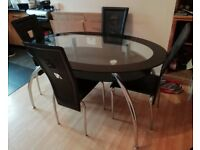 Glass dining table in a set with 4 chairs