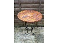 TEAK ROUND TABLE WITH ORNATE METAL LEGS