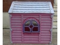 Beautiful pink playhouse with opening windows and doors