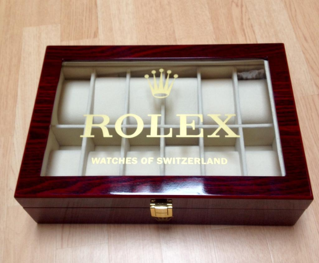 Rolex watch boxdisplay casein Kelty, FifeGumtree - Rolex watch box , holds up to 12 warches in individual suede lined compartments,exterior is cherrywood veneer highly polished and lacquered to produce high gloss finish known as piano finish, top of box has rolex in gold lettering and famous crown...