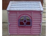 Pretty pink playhouse with opening windows and doors