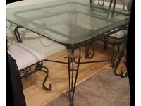 Beautiful Glass top metal Dinning table and chairs
