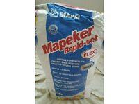 Tile adhesive. Mapei Mapeker rapid set flex. Grey.