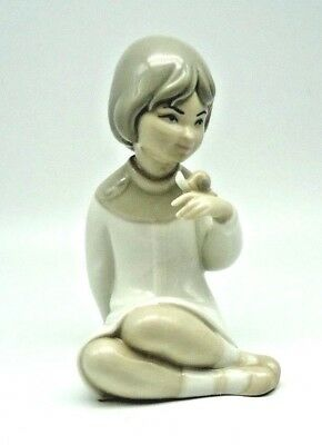 Porceval GIRLSitting WITH SNAIL on Hand shiny glaze  Made in Spain