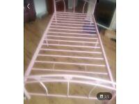 2 x pink metal single beds