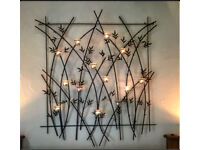 Large wrought iron wall hanging with tea light holders from John Lewis