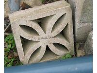 Four decorative concrete voided blocks