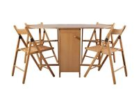 Used once butterfly table and chairs