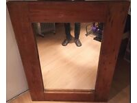 Large mirror with thick wooden frame