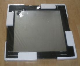 Brand new --Unusual black glass framed mirror (Packaged)