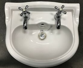 Wall hung basin fixture 450 fixed taps included good condition