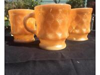 Set of 4 previously owned Anchor Hocking Fire king Peach Mugs Kimberley Pattern