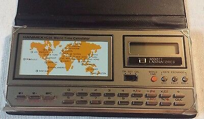 Hanimex HC24 World Time Calculator branded - Labeled Abbott Laboratories