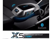 Wireless In-car adaptor X BLuetooth fm transmitter (can be linked to your phone) handsfree calls