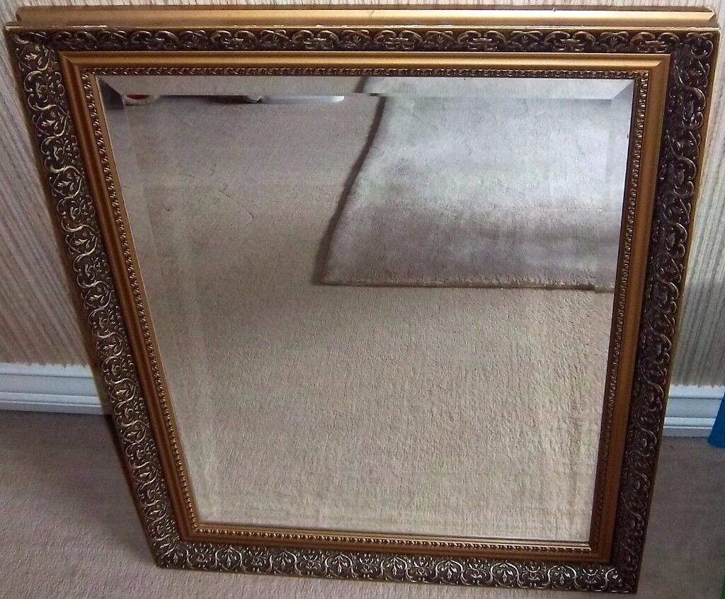 ORNATE GILT MIRROR WITH BEVELLED EDGE GLASS - 71 CMS X 56 CMS