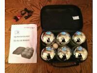 Boules ball game with metallic balls