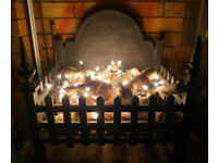 Cast Iron Fire Fireplace Dog Grate Wood Log Basket with logs and fairy lights
