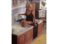 Bath Lift by Bath – Knight. A simple powered aid to assist easy access to bath