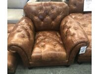 Brown leather chesterfield armchair and footstool