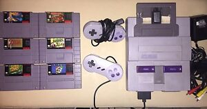 SNES with 6 games , all hook ups!