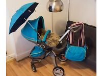 Stokke Xplory V4 with 2 IZI Go Car Seats, Carry Cot and so many other Accessories.
