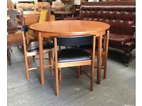 ** McINTOSH TEAK MID CENTURY EXTENDING DINING TABLE & CHAIRS **