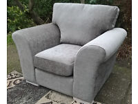 A New Designer Light Brown Fabric Material Arm Chair.