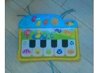 Kick and play cot piano