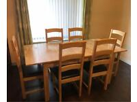 wooden dining table with 6 chairs faux leather