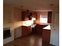 2 bedroom modern Top floor apartment with integrated kitchen appliances unfurnished.