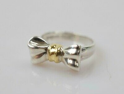 Tiffany Bow Ring (Tiffany & Co. Sterling Silver & 18K Yellow Gold Size 6 Ribbon Bow Band Ring)