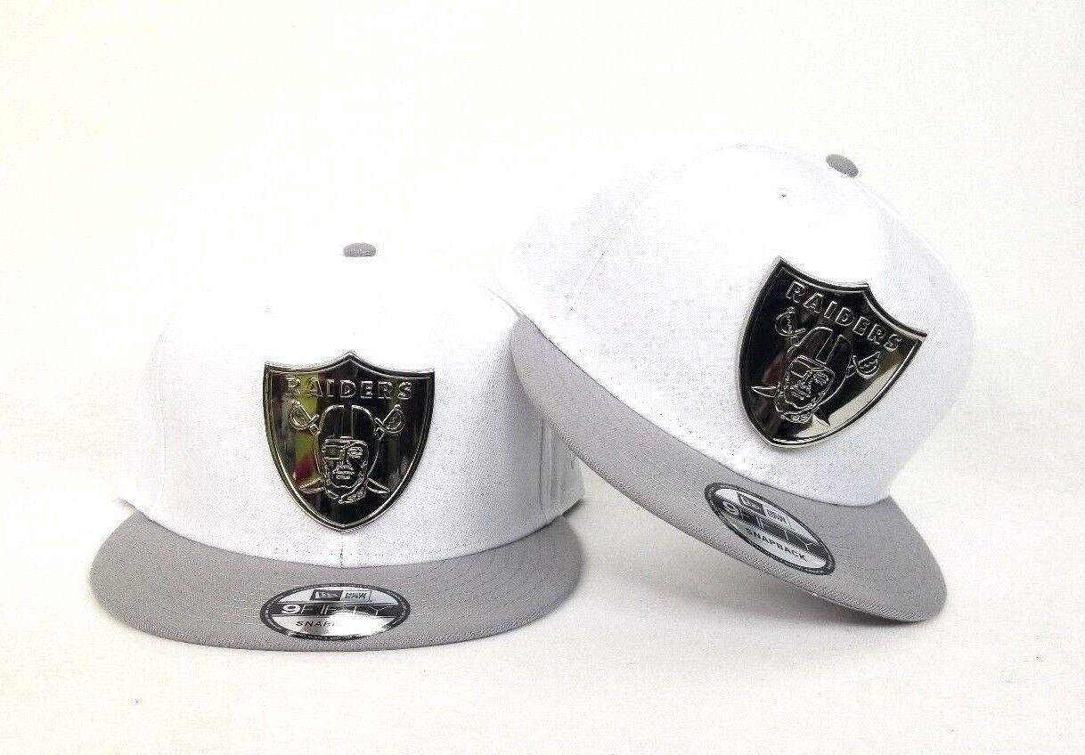 a54299ef8aaff9 New Era NFL White - Gray Oakland Raiders Silver Metal Badge Snapback Hat