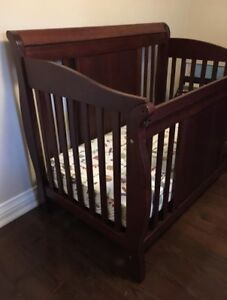 Cherry wood sleigh crib