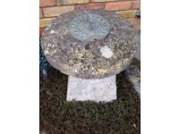 Staddle stone with sundial. Garden statue