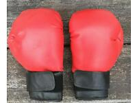 Two Red medium sparring boxing gloves