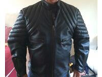 Black leather bikers jacket size Xl.