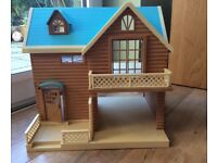 Sylvanian Families lakeside lodge with characters and furniture