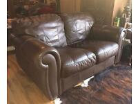 Designer Leather Two Seater Sofa Very Comfy & relaxing to sit on can arrange delivery manchester