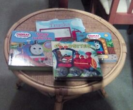 Four different books. Two are about Thomas and Friends. One is about opposites. One is trucks.