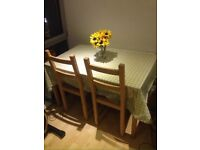 IKEA dining table with 4 chairs in great condition