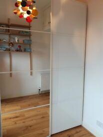 Pax wardrobe 150w X 236h cm, 2 sliding doors( 1 mirrored), white stained oak