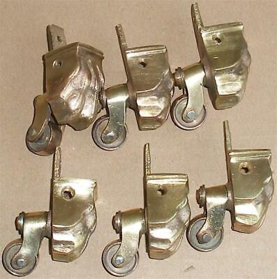 VINTAGE 6 BRASS FURNITURE LION CLAW FOOT SWIVEL CASTERS.