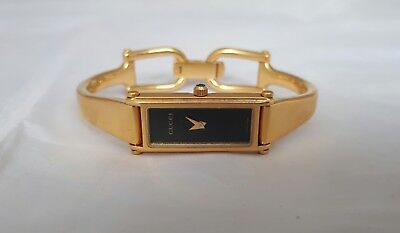 LADIES GUCCI WATCH GOLD BLACK FACE 1500L STAINLESS STEEL SWISS MADE