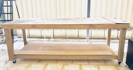 Work bench / table with storage compartment