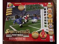 Lego style Sports Stars football pitch and play set.