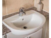 White ceramic bathroom sink with mixer tap