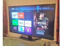 """LG 42"""" LED TV WITH ROKU STREAMING STICK, EXCELLENT CONDITION."""